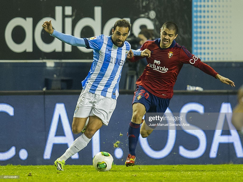 Jesus Gamez of Malaga CF duels for the ball with Francisco Andres Silva of CA Osasuna during the Copa del Rey Round of 32 matchÊbetween CA Osasuna and Malaga CF at Estadio Reyo de Navarra on December 17, 2013 in Pamplona, Spain.