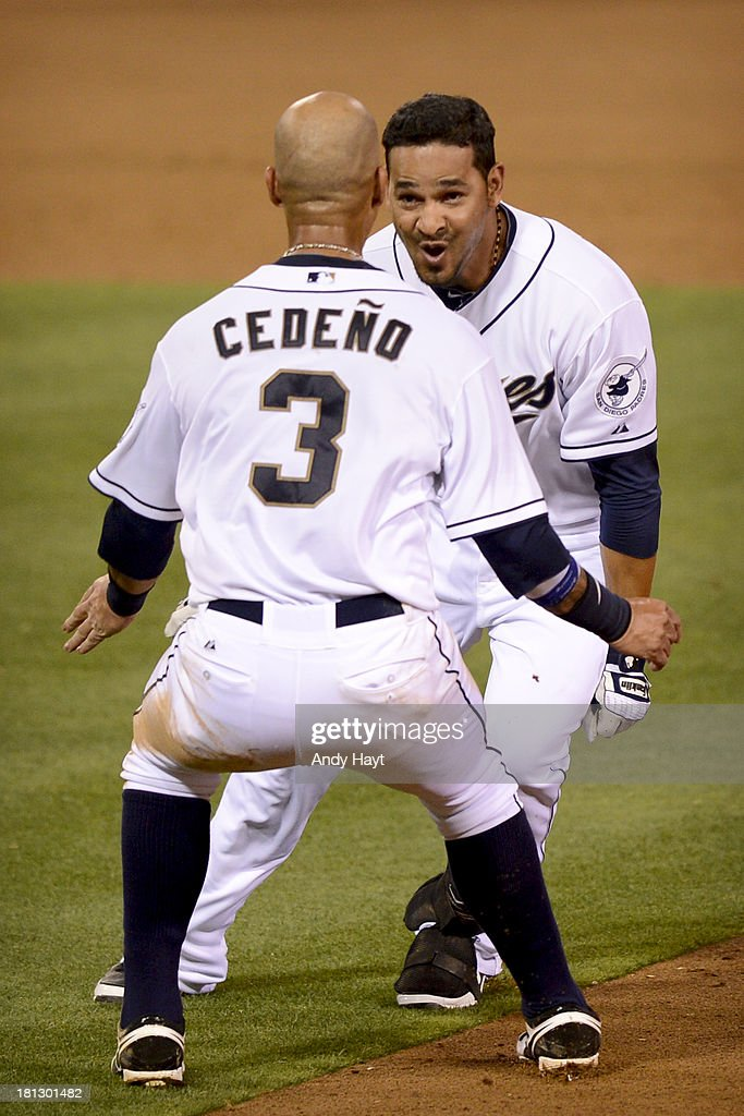 Jesus Guzman celebrates with Ronny Cedeno of the San Diego Padres after he hit a walkoff single during the ninth inning of a baseball game against...