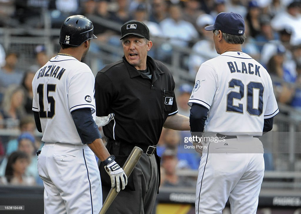 Jesus Guzman #15 of the San Diego Padres (L), and manager <a gi-track='captionPersonalityLinkClicked' href=/galleries/search?phrase=Bud+Black&family=editorial&specificpeople=167104 ng-click='$event.stopPropagation()'>Bud Black</a> (R), argue with home plate umpire <a gi-track='captionPersonalityLinkClicked' href=/galleries/search?phrase=Eric+Cooper&family=editorial&specificpeople=239458 ng-click='$event.stopPropagation()'>Eric Cooper</a> after Guzman struck out during the sixth inning of a baseball game at Petco Park on September 26, 2012 in San Diego, California.