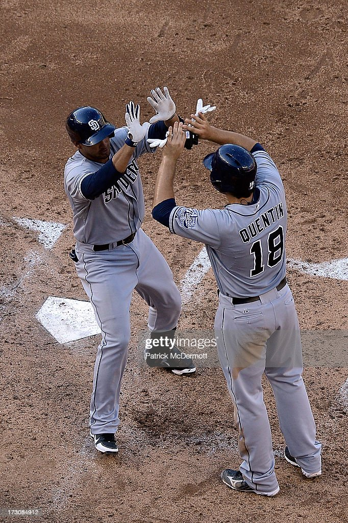 Jesus Guzman #15 of the San Diego Padres celebrates with <a gi-track='captionPersonalityLinkClicked' href=/galleries/search?phrase=Carlos+Quentin&family=editorial&specificpeople=836474 ng-click='$event.stopPropagation()'>Carlos Quentin</a> #18 after hitting a three run home run in the sixth inning during a game against the Washington Nationals at Nationals Park on July 6, 2013 in Washington, DC.