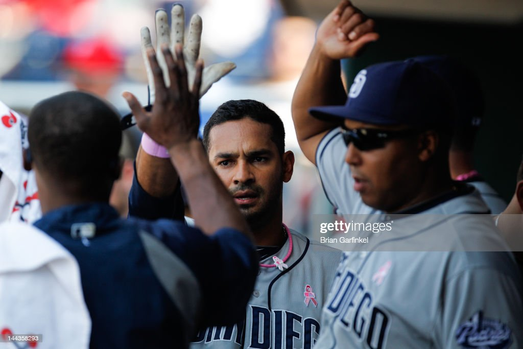 Jesus Guzman #15 of the San Diego Padres is congratulated by teammates in the dugout after scoring in the eighth inning of the game against the Philadelphia Phillies at Citizens Bank Park on May 13, 2012 in Philadelphia, Pennsylvania. The Phillies won 3-2.