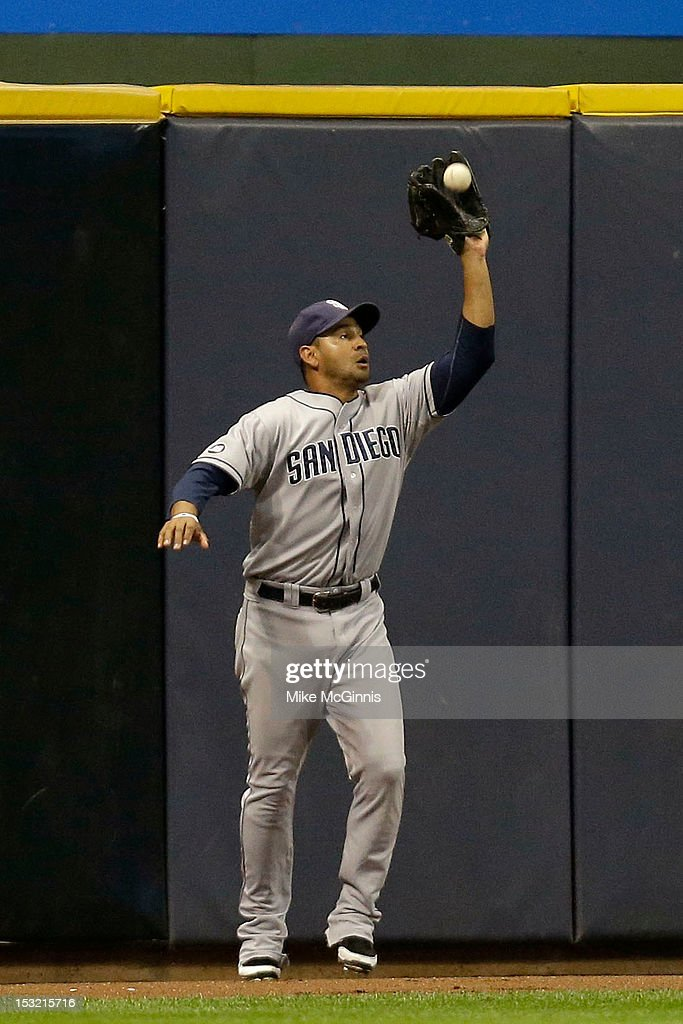 Jesus Guzman #15 of the San Diego Padres makes the catch in left field to retire Rickie Weeks of the Milwaukee Brewers during the bottom of the 7th inning at Miller Park on October 1, 2012 in Milwaukee, Wisconsin.