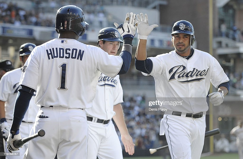 Jesus Guzman #15 of the San Diego Padres, right, is congratulated by teammate <a gi-track='captionPersonalityLinkClicked' href=/galleries/search?phrase=Orlando+Hudson&family=editorial&specificpeople=203242 ng-click='$event.stopPropagation()'>Orlando Hudson</a> #1 after Guzman hit a three-run homer during the first inning of a baseball game against the San Francisco Giants at Petco Park on July 16, 2011 in San Diego, California.