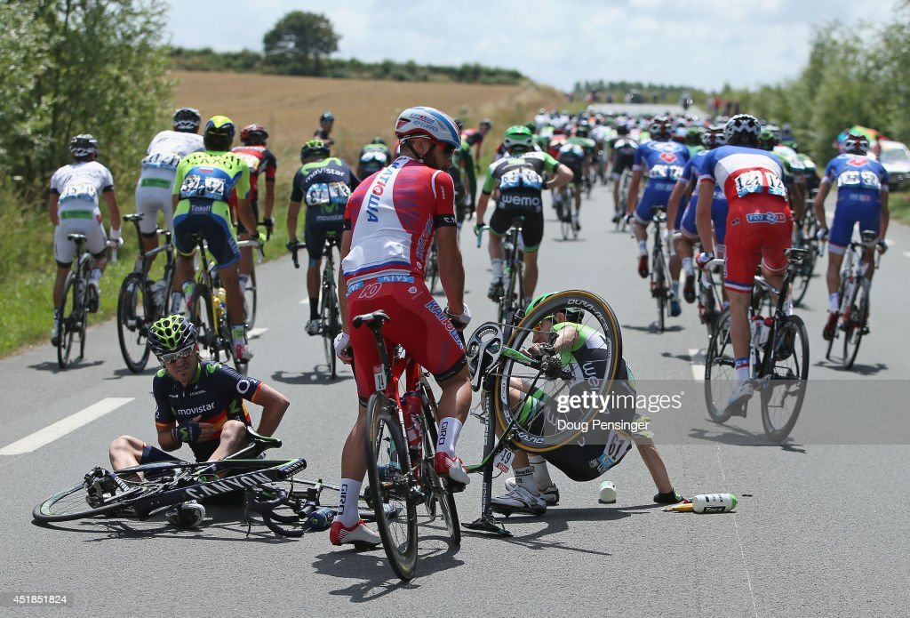 Jesus Herrada Lopez (L) of Spain and the Movistar Team and <a gi-track='captionPersonalityLinkClicked' href=/galleries/search?phrase=Bauke+Mollema&family=editorial&specificpeople=4500734 ng-click='$event.stopPropagation()'>Bauke Mollema</a> (R) of The Netherlands and the Belkin Pro Cycling Team pick themselves up off the road after being in a crash involving <a gi-track='captionPersonalityLinkClicked' href=/galleries/search?phrase=Chris+Froome&family=editorial&specificpeople=5428054 ng-click='$event.stopPropagation()'>Chris Froome</a> of Great Britain and Team Sky just after the start of stage four of the 2014 Le Tour de France from Le Touquet-Paris-Plage to Lille on July 8, 2014 in Le Touquet-Paris-Plage, France.