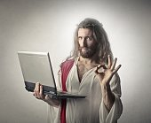 Jesus Christ with a éaptop in his hand shows, that he is sutisfied