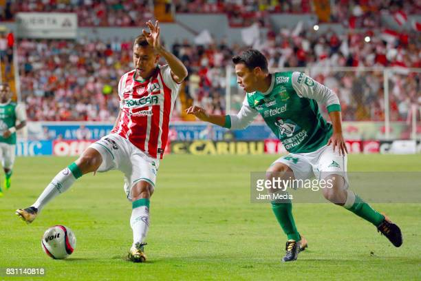 Jesus Isijara of Necaxa and Osvaldo Rodriguez of Leon fight for the ball during the 4th round match between Necaxa and Leon as part of the Torneo...
