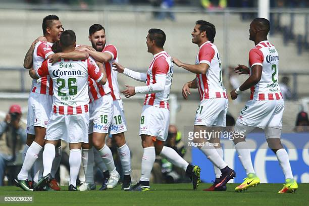 Jesus Isijara of Necaxa celebrates with teammates after scoring the first goal of his team during the 4th round match between Pumas UNAM and Necaxa...