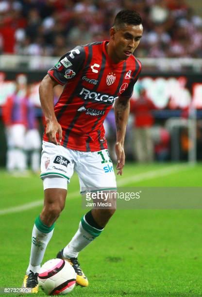 Jesus Isijara of Necaxa drives the ball during the third round match between Chivas and Necaxa as part of the Torneo Apertura 2017 Liga MX at Chivas...