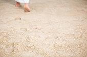 Jesus Christ walking and leaving footrpints in sand