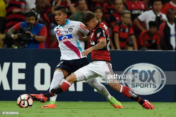 Jesus Leon of Colombia's Junior de Barranquilla fights for the ball with Gustavo Cuellar of Brazil's Flamengo during their Copa Sudamericana first...