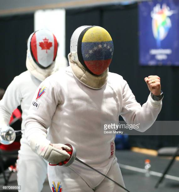 Jesus Limardo of Venezuela celebrates making a touch against Maxime BrinckCroteau of Canada during semifinal action in the Team Men's Epee event on...