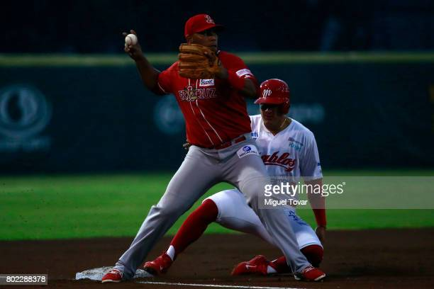 Jesus Lopez of Diablos is tagged out in third base during the match between Rojos del Aguila and Diablos Rojos as part of the Liga Mexicana de...