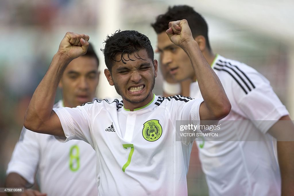 Jesus Manuel Corona of Mexico celebrates after scoring against Guatemala during their friendly football match at the Victor Manuel Reyna stadium on...