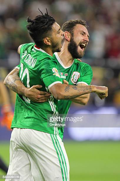 Jesus Manuel Corona of Mexico celebrates with teammate Miguel Layun after scoring the first goal of his team during a group C match between Mexico...