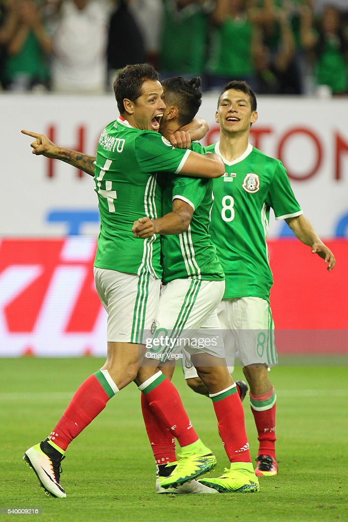 Jesus Manuel Corona of Mexico celebrates with teammates Javier Hernandez and Hirving Lozano after scoring the first goal of his team during a group C...