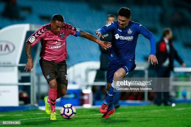 Jesus Manuel Santana alias Suso NT of CD Tenerife competes for the ball with Alejandro Faurlin of Getafe CF during the La Liga second league match...