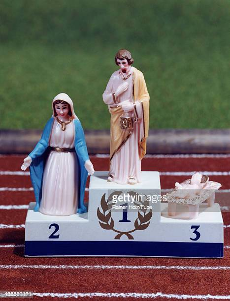 Jesus, Mary and Joseph on Winner's Podium