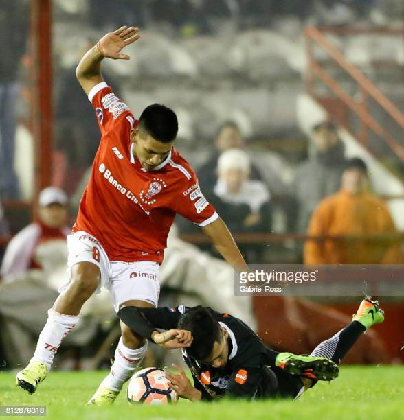 Jesus Medina of Libertad fights for the ball with Leandro Cuomo of Huracan during a first leg match between Huracan and Libertad as part of second...