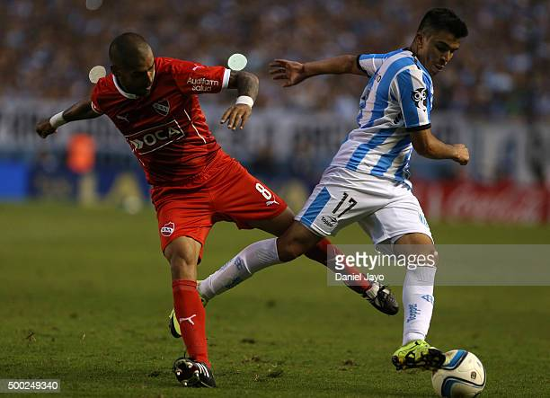 Jesus Mendez of Independiente and Marcos Acuña of Racing Club struggle for the ball during a second leg match between Independiente and Racing Club...