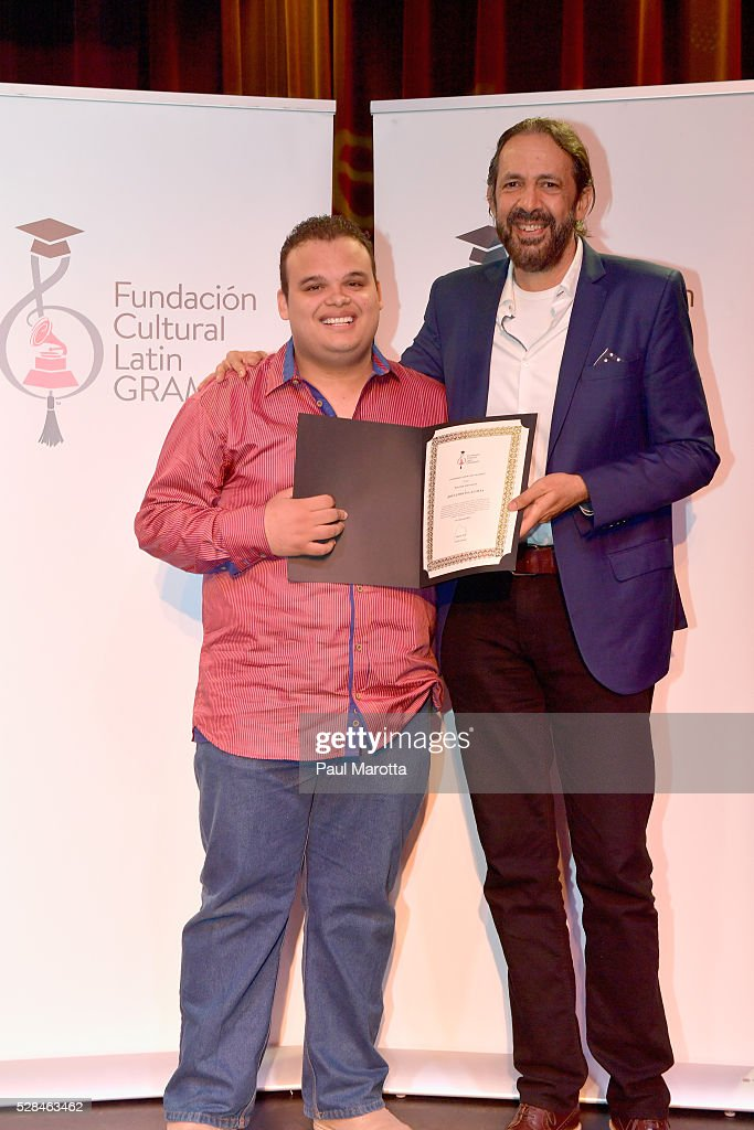 Jesus Molina Acosta (L), winner of the 2016 Juan Luis Guerra Scholarship, presented by the Latin GRAMMY Cultural Foundation, and singer, song writer, composer and producer Juan Luis Guerra (R) at Berklee College of Music on May 5, 2016 in Boston, Massachusetts.
