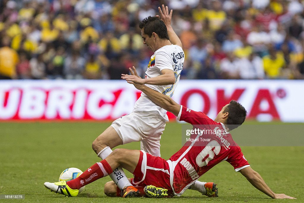 Jesus Molina of America fights for the ball with Carlos Rodriguez of Toluca during a Clausura 2013 Liga MX match between America and Toluca at Azteca Stadium on February 16, 2013 in Mexico City, Mexico.