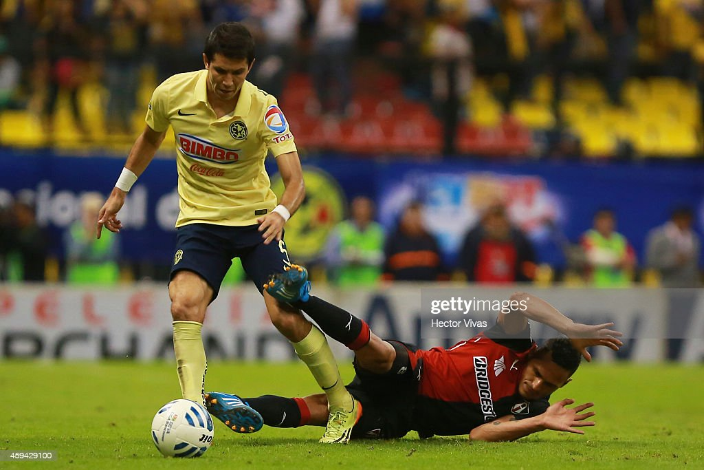 Jesus Molina of America struggles for the ball with Aldo Leao of Atlas during a match between America and Atlas as part of 17th round Apertura 2014 Liga MX at Azteca Stadium on November 22, 2014 in Mexico City, Mexico.