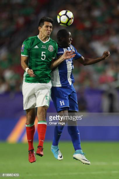 Jesus Molina of Mexico and Oscar Boniek of Honduras go for a header during the CONCACAF Gold Cup 2017 quarterfinal match between Mexico and Honduras...