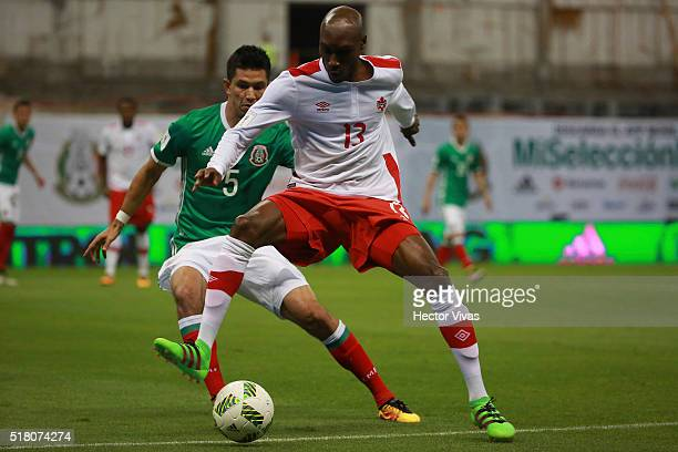 Jesus Molina of Mexico struggles for the ball with Atiba Hutchinson of Canada during the match between Mexico and Canada as part of the FIFA 2018...