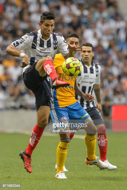 Jesus Molina of Monterrey controls the ball while observed by Ismael Sosa of Tigres during the 15th round match between Monterrey and Tigres UANL as...