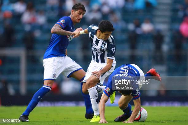 Jesus Molina of Monterrey struggles for the ball with Francisco Silva of Cruz Azul during the seventh round match between Cruz Azul and Monterrey as...