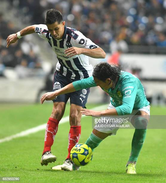 Jesus Molina of Monterrey vies for the ball with Ignacio Gonzalez of Leon during the Mexican Clausura 2017 tournament football match at the BBVA...