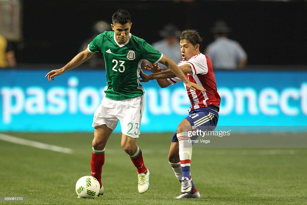 Jesus Molinaof Mexico and Oscar Romero of Paraguay fight for the ball during the International Friendly between Mexico and Paraguay at Georgia Dome on May 28, 2016 in Atlanta, Georgia.