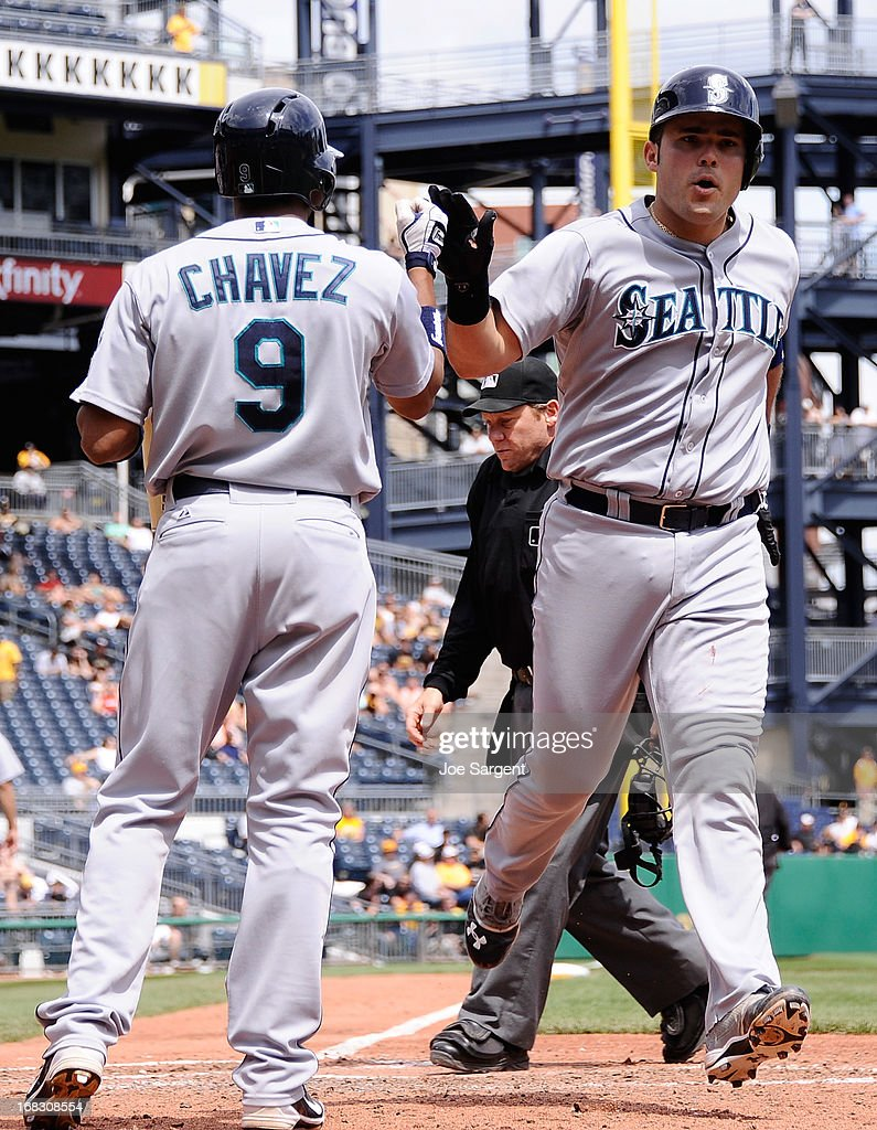 Jesus Montero #63 of the Seattle Mariners celebrates his solo home run with Endy Chavez #9 during the seventh inning against the Pittsburgh Pirates on May 8, 2013 at PNC Park in Pittsburgh, Pennsylvania. Seattle won the game 2-1.