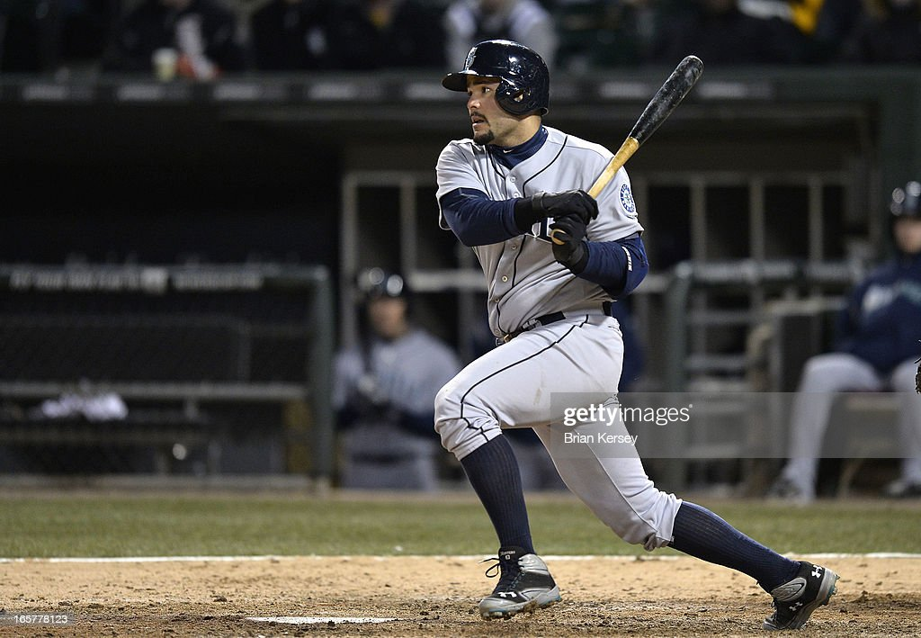 Jesus Montero #63 of the Seattle Mariners follows through on an RBI single scoring teammate Robert Andino during the tenth inning against the Chicago White Sox on April 5, 2012 at U.S. Cellular Field in Chicago, Illinois. The Mariners won 8-7 in 10 innings.