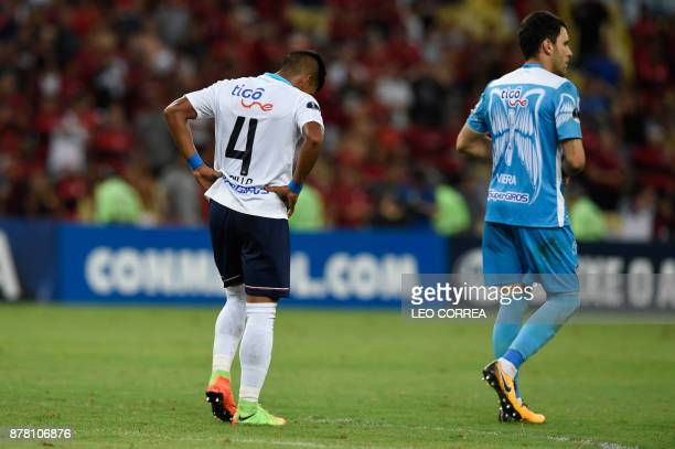 Jesus Murillo and the goalkeeper Mario Viera of Colombia's Junior de Barranquilla walk on the field after their Copa Sudamericana 1st leg Semi Final...