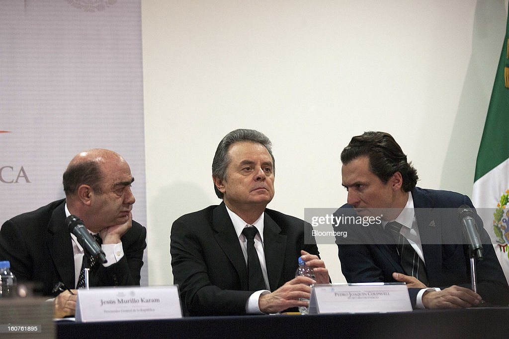 Jesus Murillo Karam, Mexico's attorney general, from left, Pedro Joaquin Coldwell, energy minister, and Emilio Lozoya Austin, chief executive officer of Petroleos Mexicanos (Pemex), hold a news conference in Mexico City, Mexico, on Monday, Feb. 4, 2013. The blast that killed 37 people at state-owned oil company Petroleos Mexicanos's headquarters in Mexico City last week was caused by gas buildup, Murillo said, the first government explanation for the nation's deadliest explosion since 2006. Photographer: Susana Gonzalez/Bloomberg via Getty Images