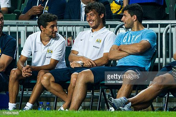 Jesus Navas David Silva and Sergio Aguero of Manchester City sit at the bench during the Barclays Asia Trophy Semi Final match between Manchester...
