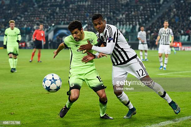 Jesus Navas of Manchester City and Alex Sandro of Juventus battle for the ball during the UEFA Champions League group D match between Juventus and...