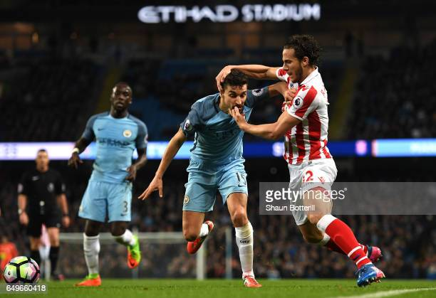 Jesus Navas of Manchester City and Ramadan Sobhi of Stoke City in action during the Premier League match between Manchester City and Stoke City at...
