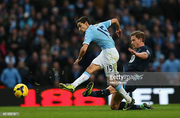 Jesus Navas of Manchester City beats a tackle from Jan Vertonghen of Tottenham Hotspur to score the sixth goal during the Barclays Premier League...