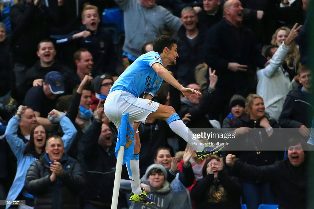 Jesus Navas of Manchester City celebrates after scoring his team's second goal during the Barclays Premier League match between Manchester City and Cardiff City at the Etihad Stadium on January 18, 2014 in Manchester, England.