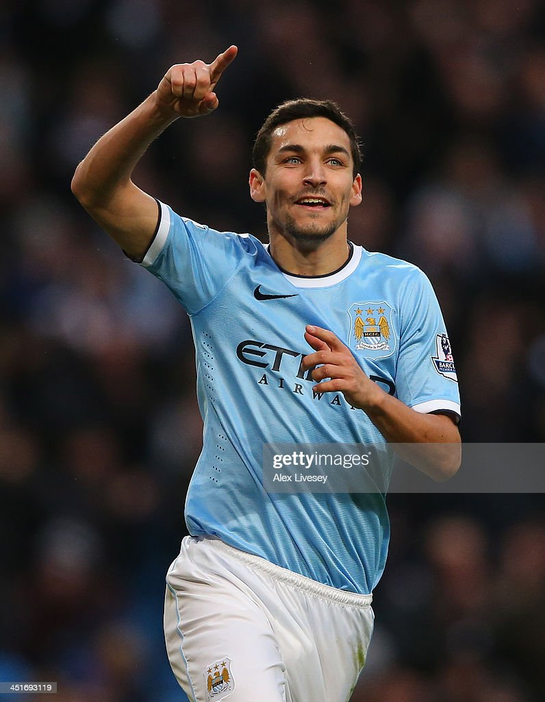Jesus Navas of Manchester City celebrates after scoring the sixth goal during the Barclays Premier League match between Manchester City and Tottenham Hotspur at Etihad Stadium on November 24, 2013 in Manchester, England.