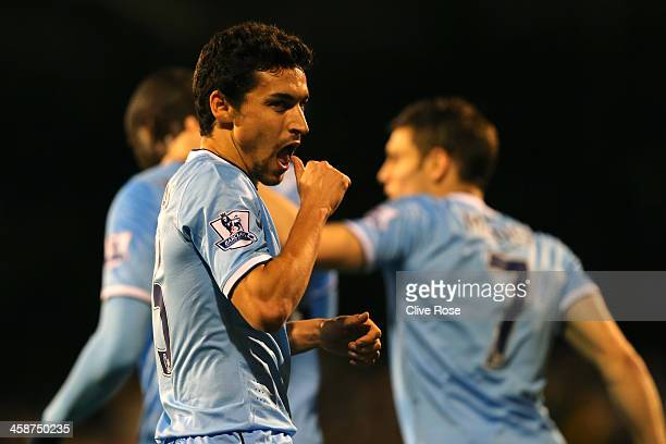 Jesus Navas of Manchester City celebrates scoring their third goal during the Barclays Premier League match between Fulham and Manchester City at...