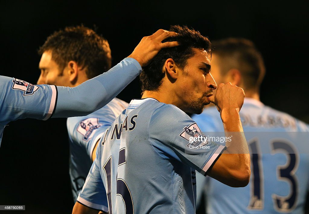 Jesus Navas of Manchester City celebrates scoring their third goal during the Barclays Premier League match between Fulham and Manchester City at Craven Cottage on December 21, 2013 in London, England.
