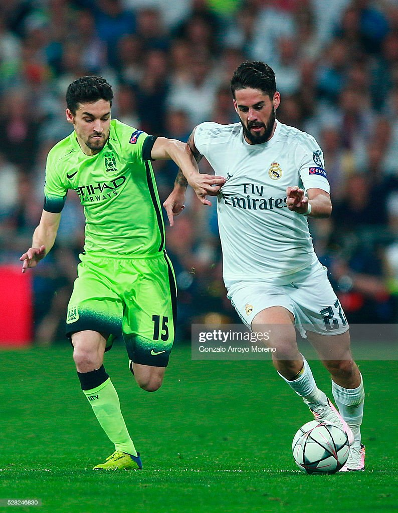 Jesus Navas of Manchester City chases <a gi-track='captionPersonalityLinkClicked' href=/galleries/search?phrase=Isco&family=editorial&specificpeople=5848609 ng-click='$event.stopPropagation()'>Isco</a> of Real Madrid during the UEFA Champions League semi final, second leg match between Real Madrid and Manchester City FC at Estadio Santiago Bernabeu on May 4, 2016 in Madrid, Spain.