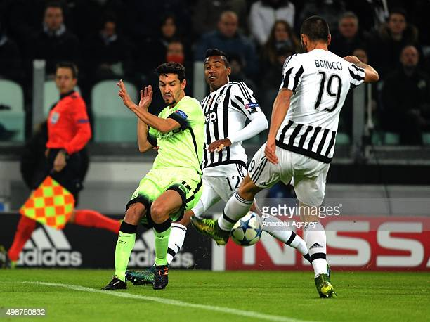 Jesus Navas of Manchester City competes for the ball with Alex Sandro and Leonardo Bonucci of FC Juventus during the UEFA Champions League Group D...