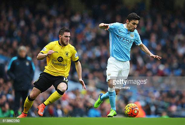 Jesus Navas of Manchester City controls the ball under pressure of Jordan Veretout of Aston Villa during the Barclays Premier League match between...