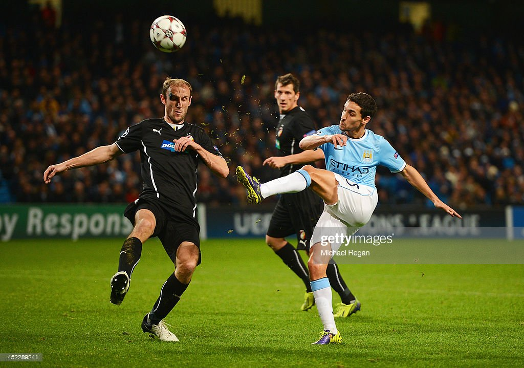 Jesus Navas of Manchester City is closed down by <a gi-track='captionPersonalityLinkClicked' href=/galleries/search?phrase=Roman+Hubnik&family=editorial&specificpeople=2156652 ng-click='$event.stopPropagation()'>Roman Hubnik</a> of Plzen during the UEFA Champions League Group D match between Manchester City and FC Viktoria Plzen at Etihad Stadium on November 27, 2013 in Manchester, England.