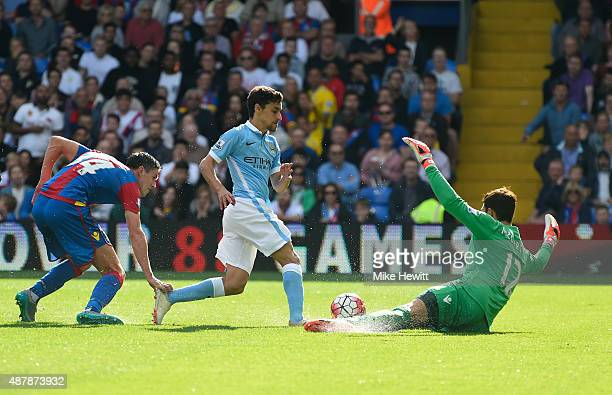 Jesus Navas of Manchester City is faced by goalkeeper Alex McCarthy of Crystal Palace during the Barclays Premier League match between Crystal Palace...