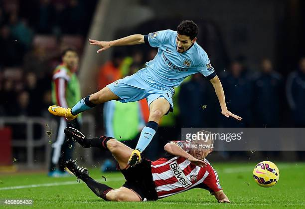 Jesus Navas of Manchester City is tackled by Lee Cattermole of Sunderland during the Barclays Premier League match between Sunderland and Manchester...